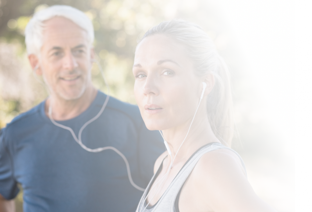 A man and a woman following an exercise physiology program outdoors